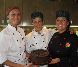 Brenda shows off her German Chocolate Cake (secret ingredient: zucchini) with assistants Meagan and Amber