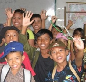 The children of Yayasan Widya Guna Orphanage celebrating -- click for more of the story behind the More than a NUT MILK BAG.