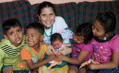 Ibu Robin with kids at Bumi Sehat Birthing Center near Ubud, Bali.
