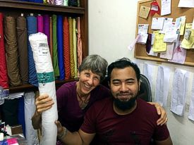 Brenda visits with Rawsome Creations fabric supplier in Bali. Maheir provides the material used to make our More Than a Nut Milk Bag. (photo by Mary-Margaret)
