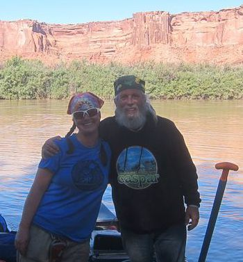 Michael and Sienna Potts, my editor/business coach/hat model and my webster, on the Green River (photo by Andy of Tex's Riverways)